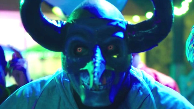 Person in mask in The Purge movie franchise
