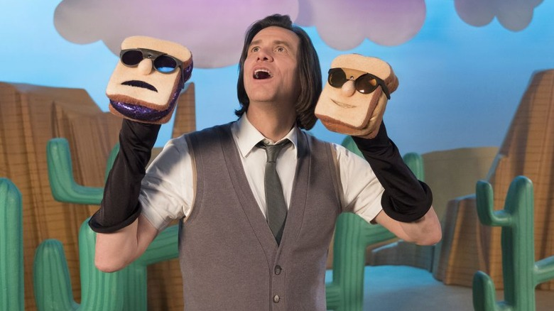 Jim Carrey  as Mr. Pickles with sandwich hand puppets in Kidding