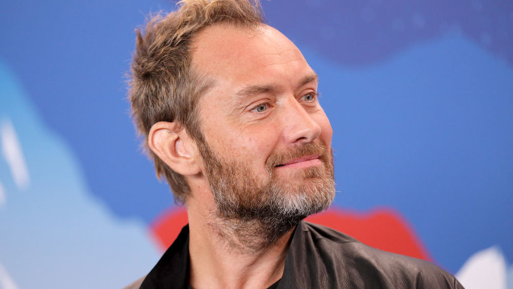 Jude Law at a panel getting interviewed