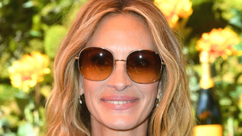 Julia Roberts smiling with sunglasses