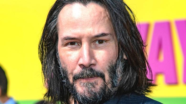 Keanu Reeves smiles