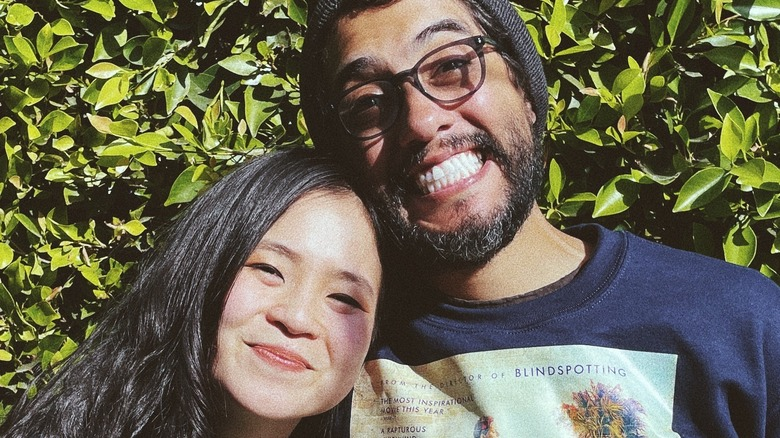 Kelly Marie Tran and Carlos Lopez Estrada smililng