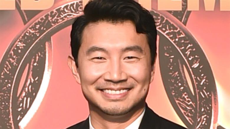 Simu Liu smiling wide