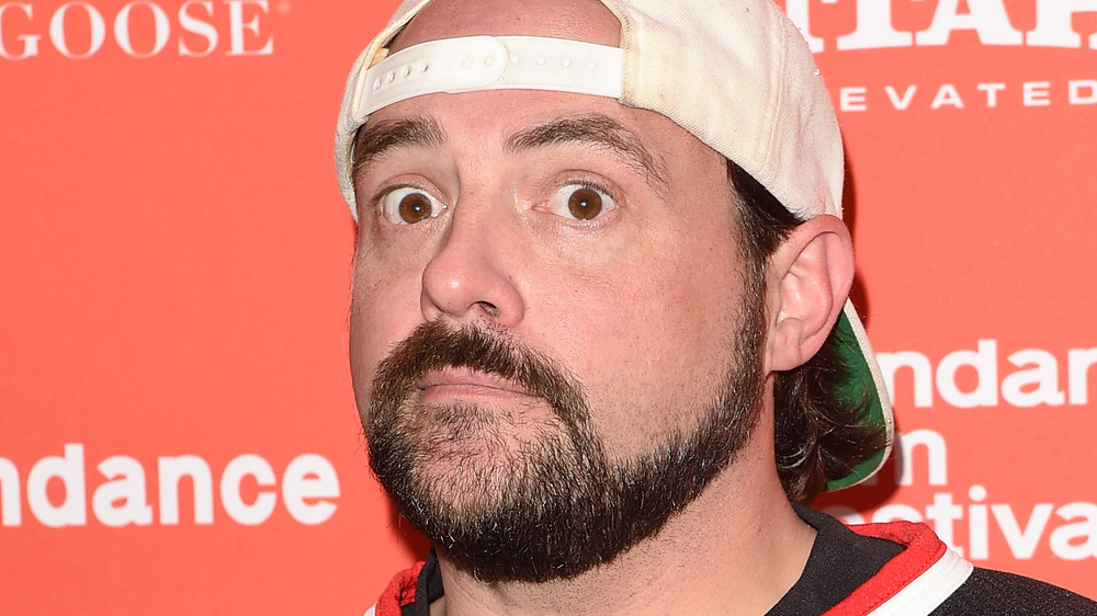Kevin Smith posing for photo