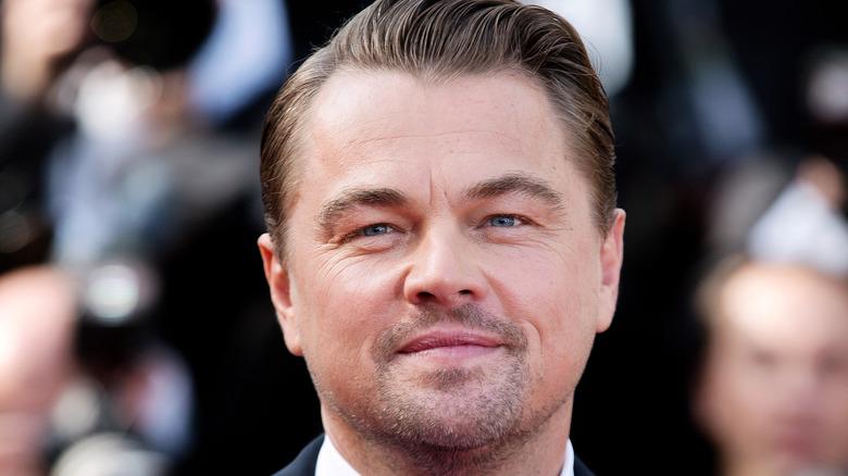Leonardo DiCaprio poses at event
