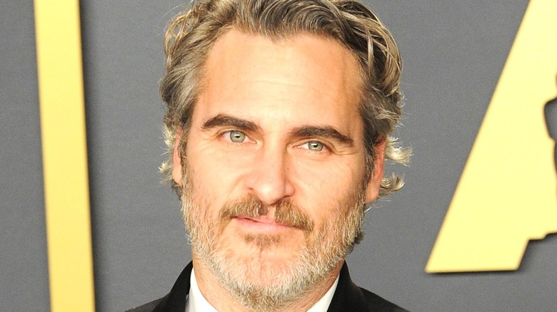 Joaquin Phoenix poses on 2020 Oscars red carpet