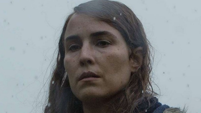 Noomi Rapace stares in shock