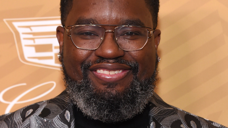 Lil Rel Howery smiling and wearing glasses