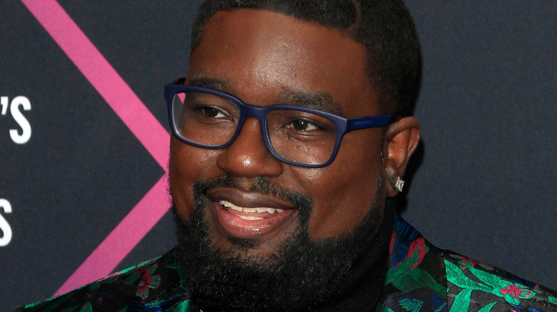 Lil Rel Howery smiling glasses