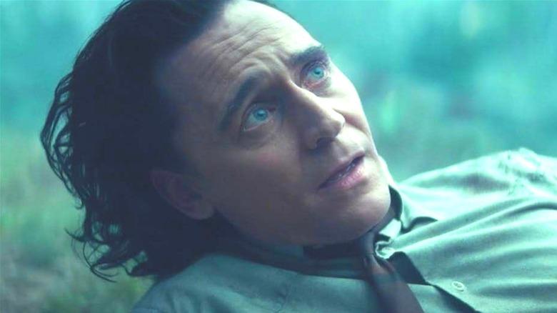 Tom Hiddleston as Loki looking up