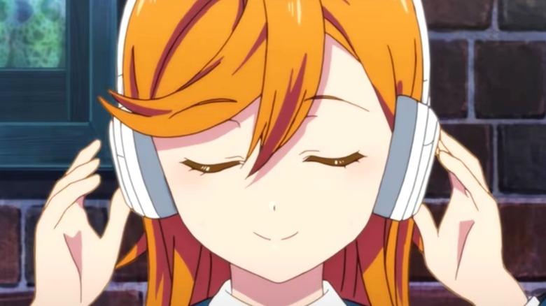 Kanon Shibuya listening with headphones