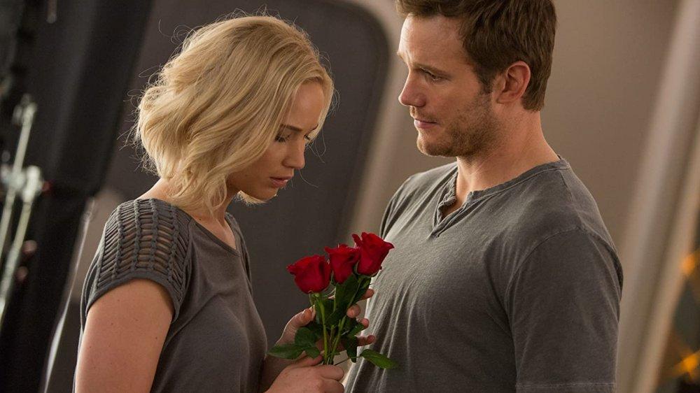 Jennifer Lawrence as Aurora Lane looks down at red roses from Chris Pratt as Jim Preston in Passengers