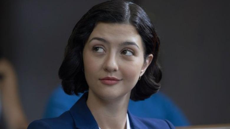 Maggie smirking