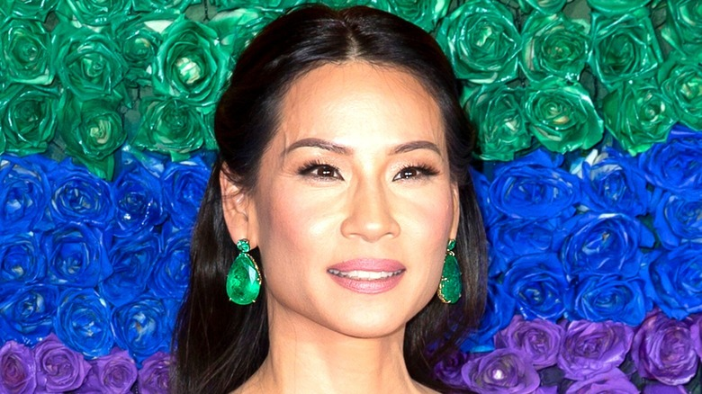 Lucy Liu poses at event