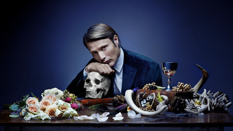 Hannibal at table with flowers and bones