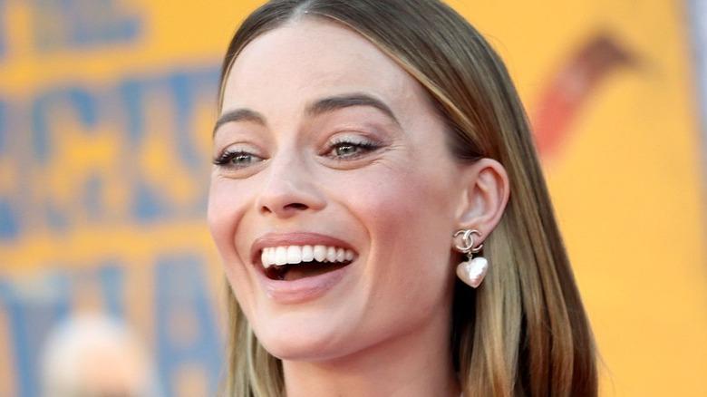 Margot Robbie smiles