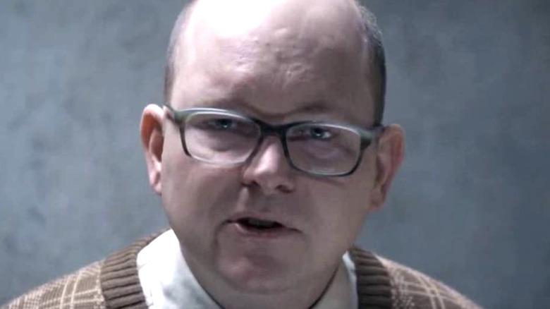 Colin Robinson wearing his glasses
