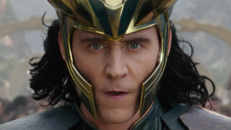 Tom Hiddleston as Loki with horned helmet
