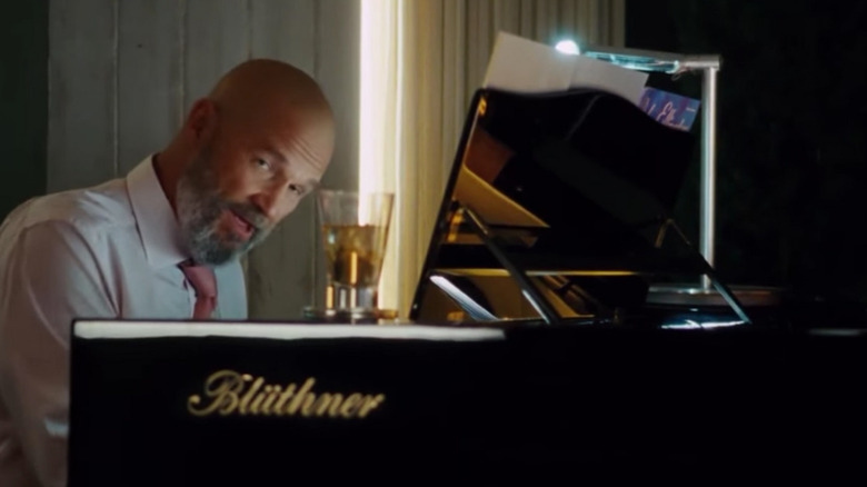 Jeff Bridges Obadiah Stane piano drink