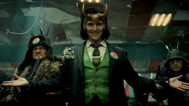 Loki grinning and spreading hands