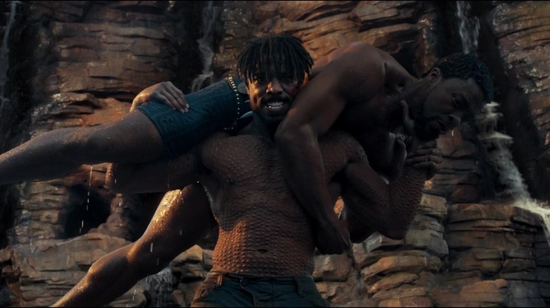 Killmonger throws T'Challa off a cliff.