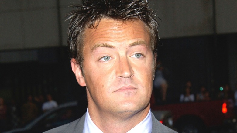 Matthew Perry expressionless