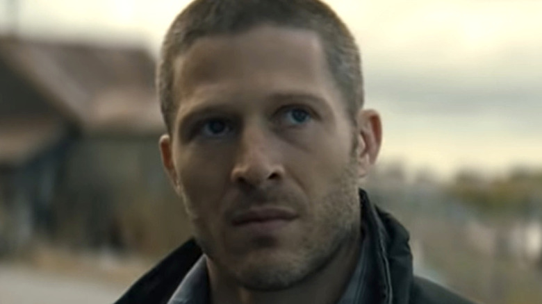 Zach Gilford looking up