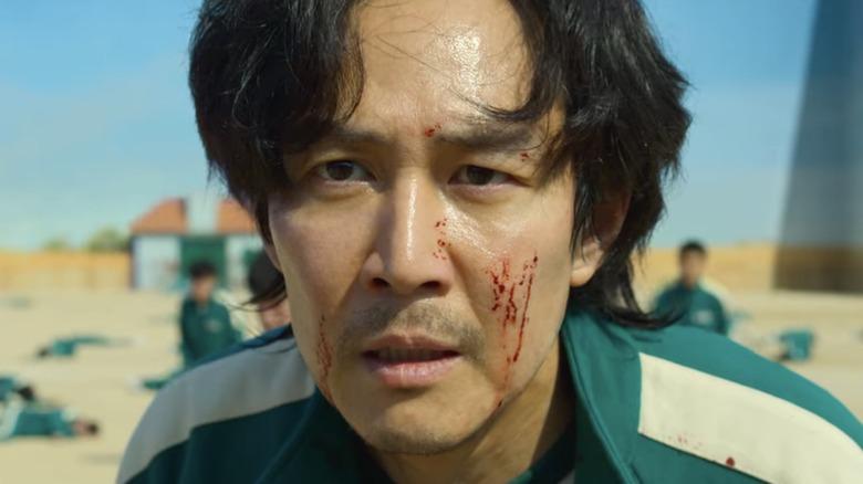 Gi-hun's stunned, bloody face