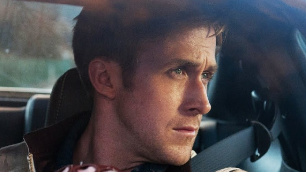 Ryan Gosling as Driver looks out his car window