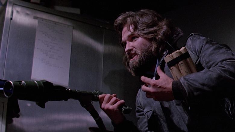 Kurt Russell holding flamethrower