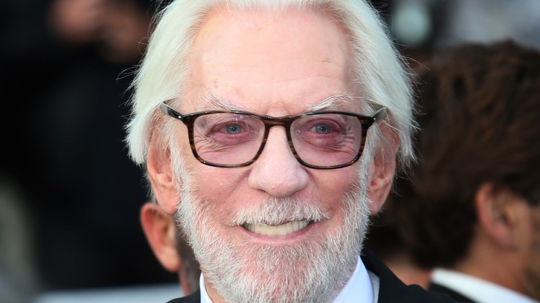 Donald Sutherland wearing tinted glasses