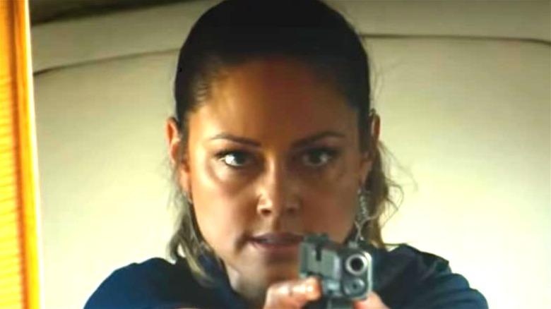 Vanessa Lachey holding a gun