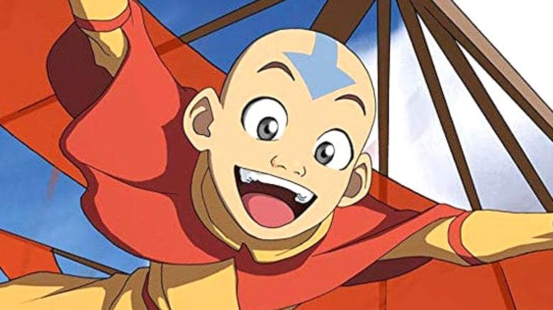 Aang flying smiling