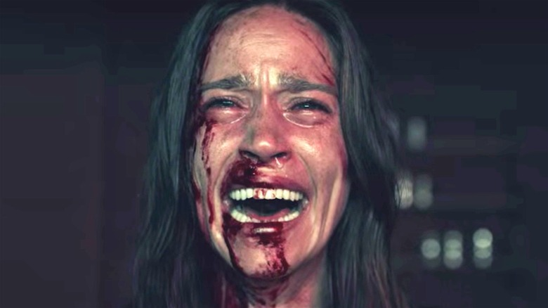 Woman crying with blood on her face