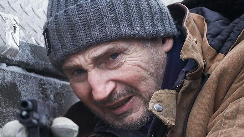 Mike McCann holding a gun