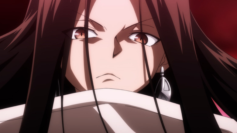 An anime character scowls