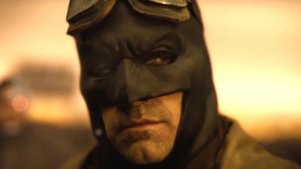 Batman stares at something in the distance