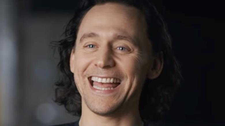 Tom Hiddleston laughing