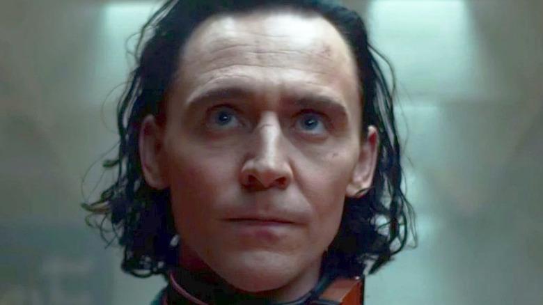 Loki with a TVA collar around his neck