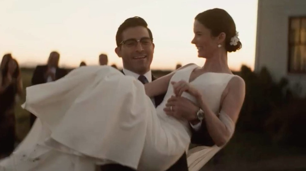 Superman holding Lois at their wedding