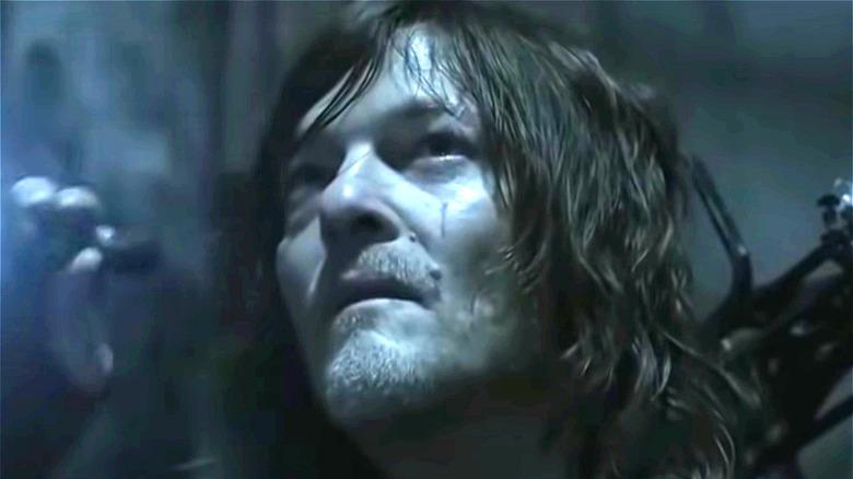 Daryl Dixon holding flashlight