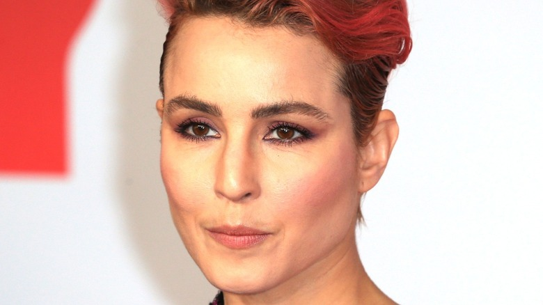 Noomi Rapace with wavy red hair