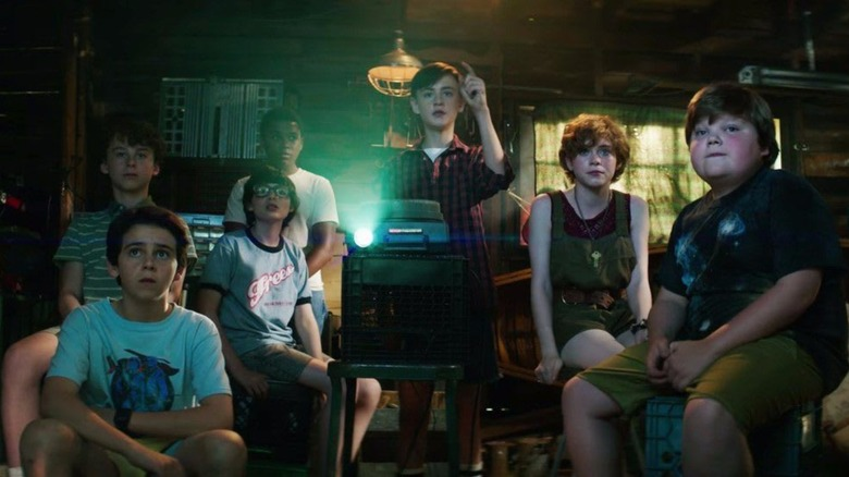 The Losers Club watch old footage of Pennywise in 2017s It