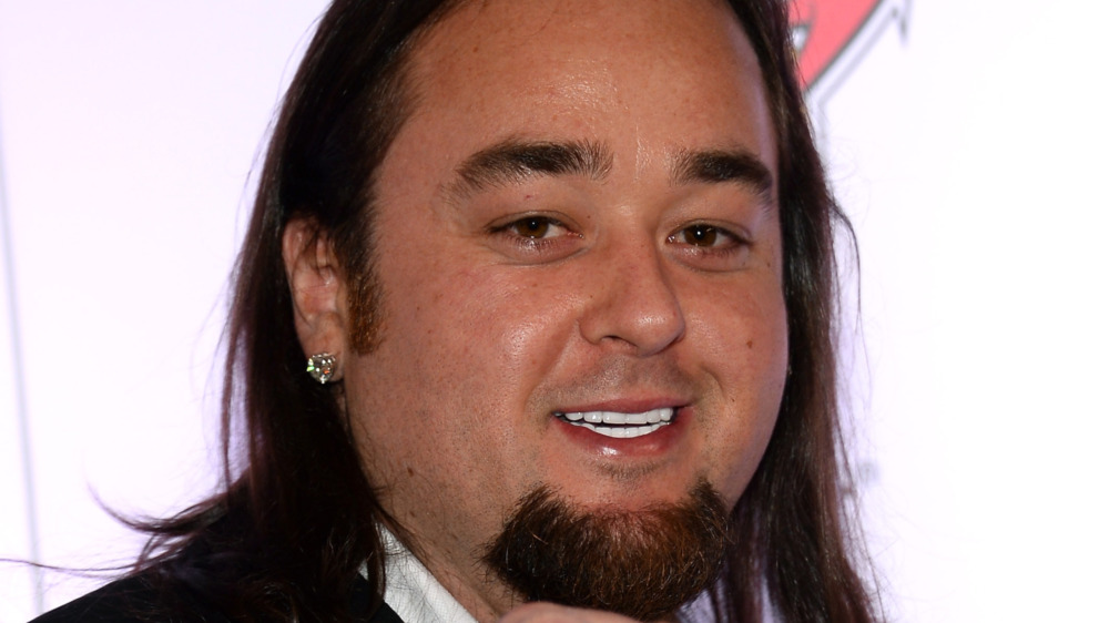 Austin Chumlee Russell smiling long hair