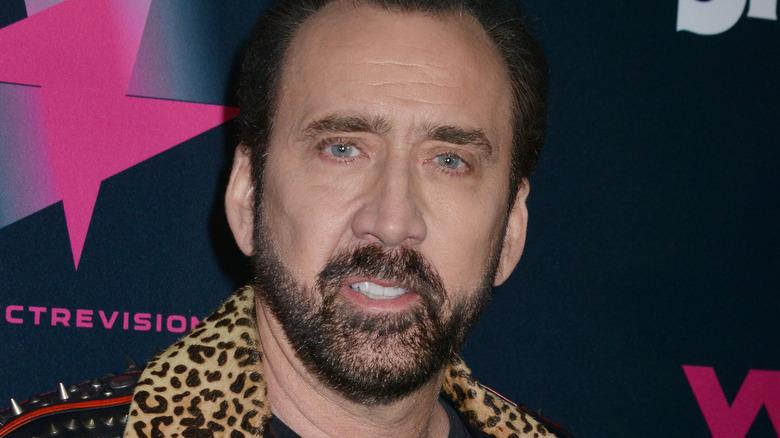 Nicolas Cage smirking