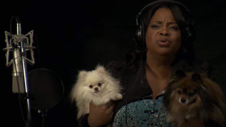 Angie Jordan holding dogs