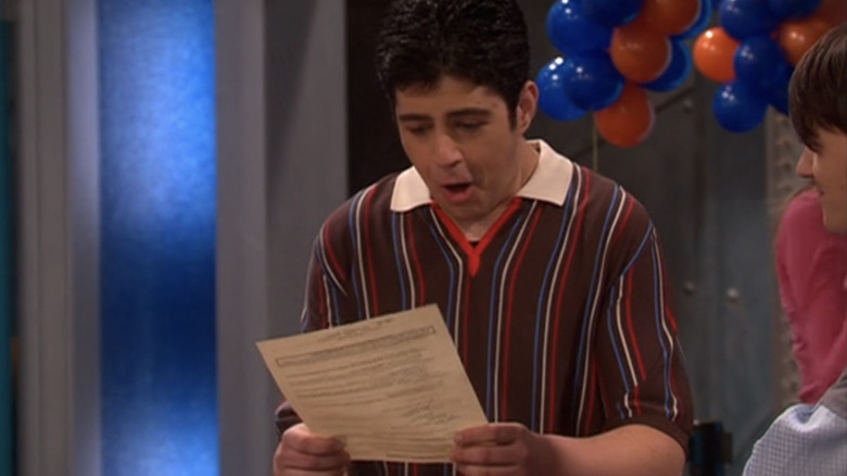 Josh marveling at paper