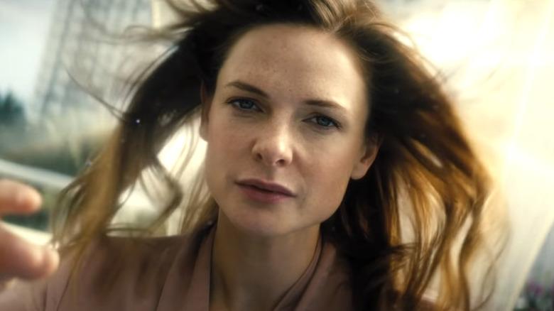Rebecca Ferguson as Mae floating