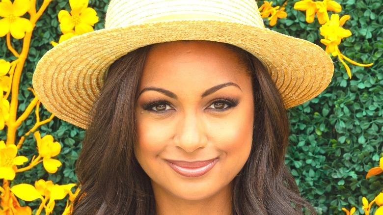 Eboni smiling in a straw hat