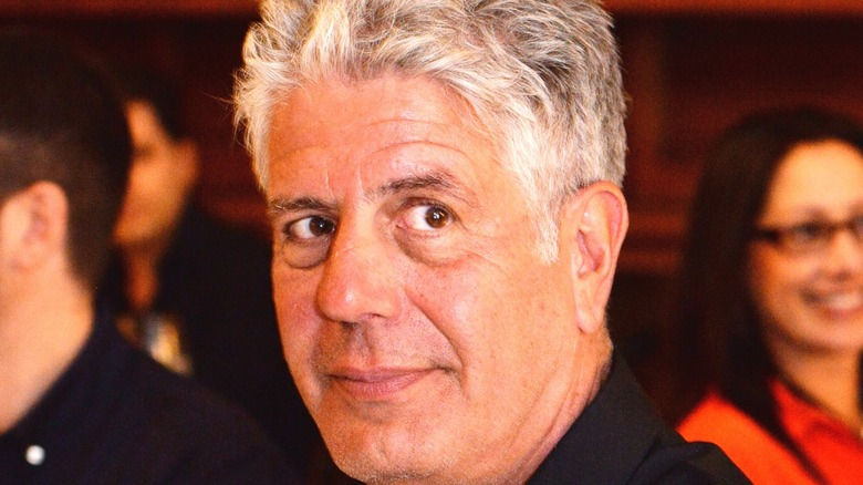 Anthony Bourdain looking on